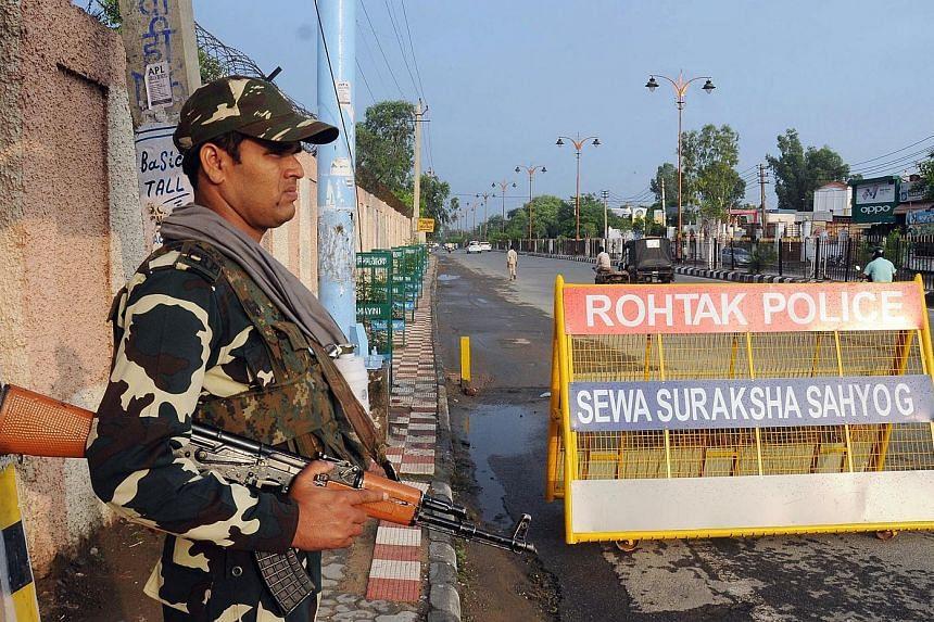 Gurmeet Ram Rahim Singh also faces charges of murder in two separate cases, and is accused of castrating 400 men inside his ashram. Security personnel on guard at one of the roads leading to Sunaria Jail where Singh was being kept, in Haryana, India,