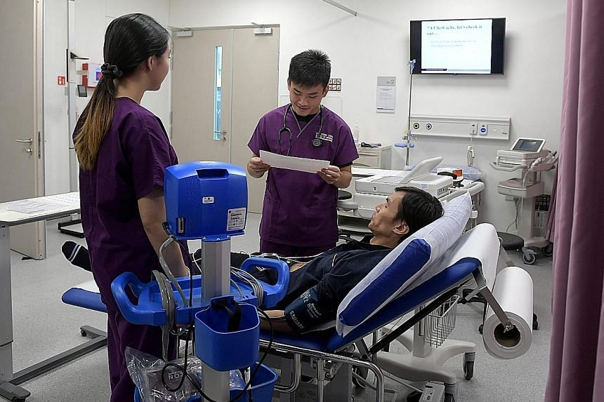 Lee Kong Chian School of Medicine students in the Centre for Clinical Simulation ward. The school is a collaboration between NTU and Imperial College London, with a curriculum that is based closely on Imperial's but adapted to suit local needs.