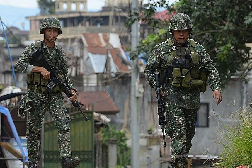 Philippine forces patrolling a deserted street in Marawi late last month. The battle is seeing its final days as troops accomplished a series of recent victories.