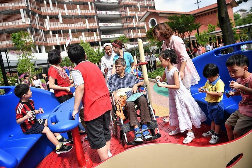 The inter-generational playground has a merry-go-round with wheel-lock features, allowing both children and seniors to ride together.