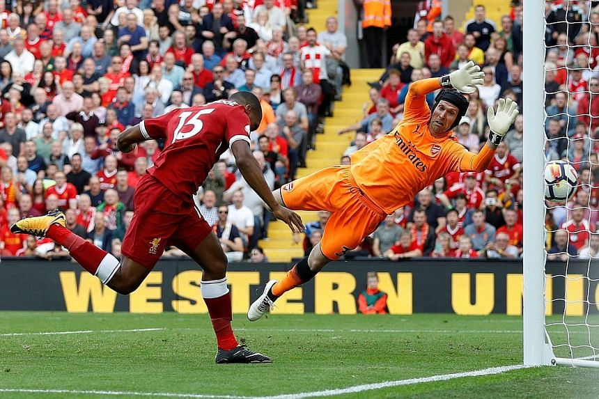 Goalkeeper Petr Cech cannot stop substitute Daniel Sturridge from heading in Liverpool's fourth goal against Arsenal on Sunday. Only West Ham (10) have conceded more Premier League goals this season than Arsenal (eight).