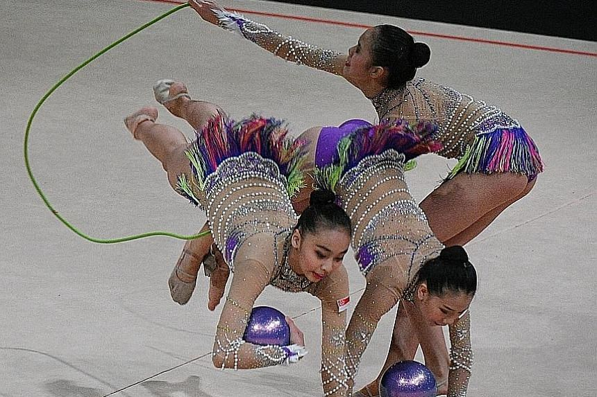 Singapore's rhythmic gymnastics team competing in the mixed apparatus final. They earned a creditable bronze despite four of the five team members participating in their first SEA Games.