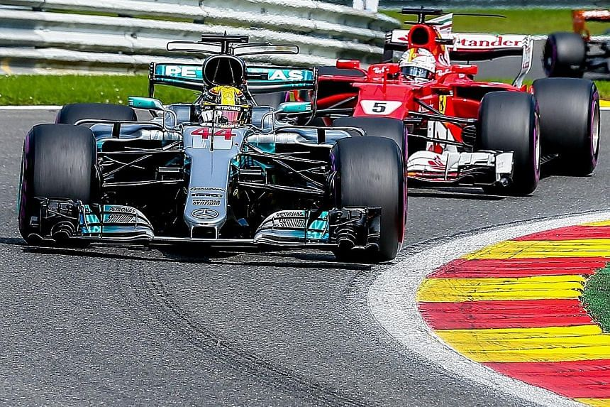 Mercedes' Lewis Hamilton leading the Belgium Grand Prix with Ferrari's Sebastian Vettel snapping at his heels. The Briton's win cut the gap between the two in the drivers' championship to seven points.