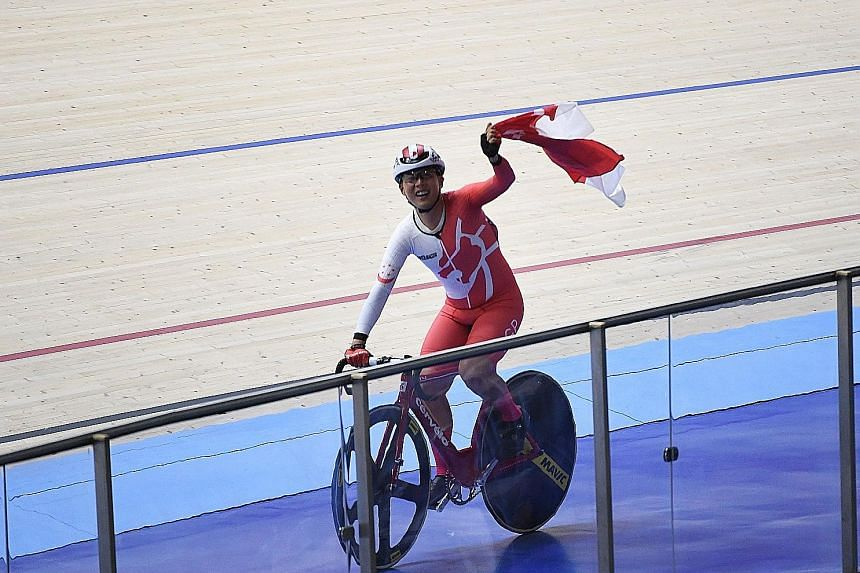 Calvin Sim waving Singapore's flag proudly at the National Velodrome in Nilai after winning the men's omnium race last night. He topped a field of 11 riders.