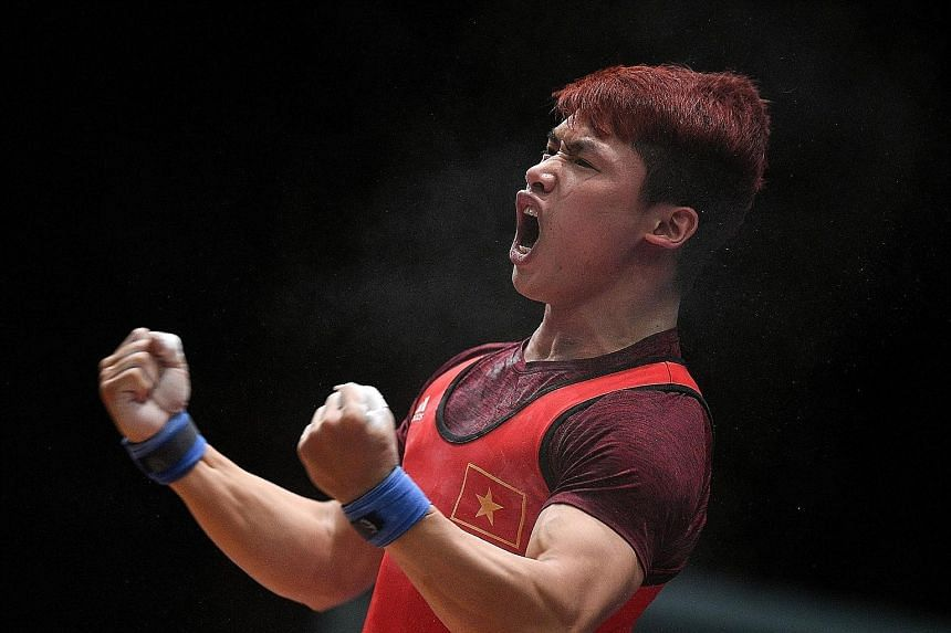 Indonesia's four-time SEA Games weightlifting champion Eko Yuli Irawan (above) showing the strain of competing in the 62kg final yesterday. He finished with the silver medal after a total of 306kg, behind Vietnam's Trinh Van Vinh, who lifted 307kg.