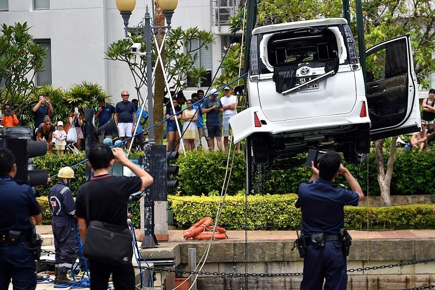 The car being hauled out of the water in Sentosa Cove on Saturday afternoon.