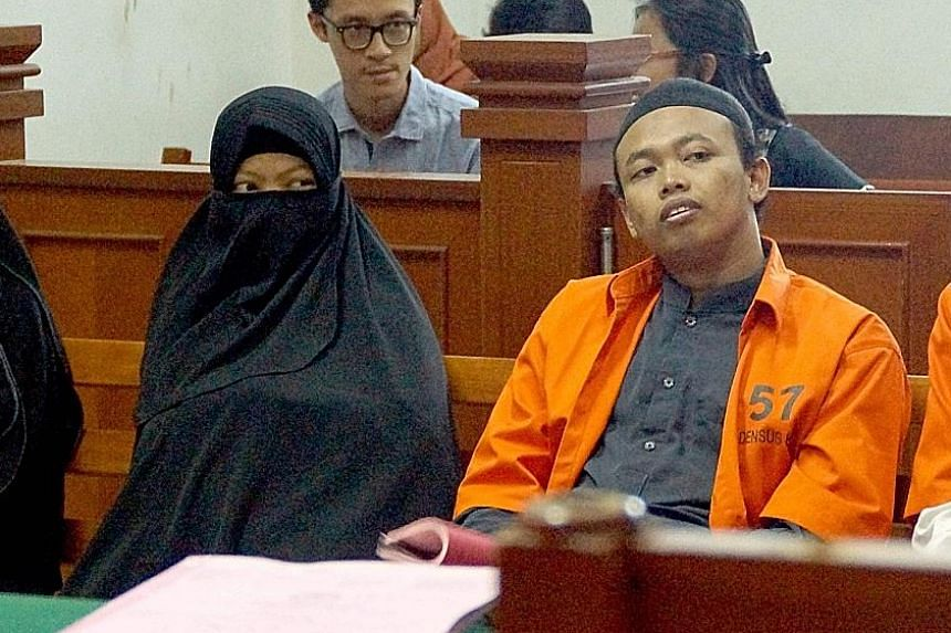 Dian Yulia Novi with her husband Nur Solihin at East Jakarta District Court in Jakarta last week. She was arrested last December at her rented house near Jakarta with a 3kg high-grade rice-cooker bomb, a day before the planned strike on the president