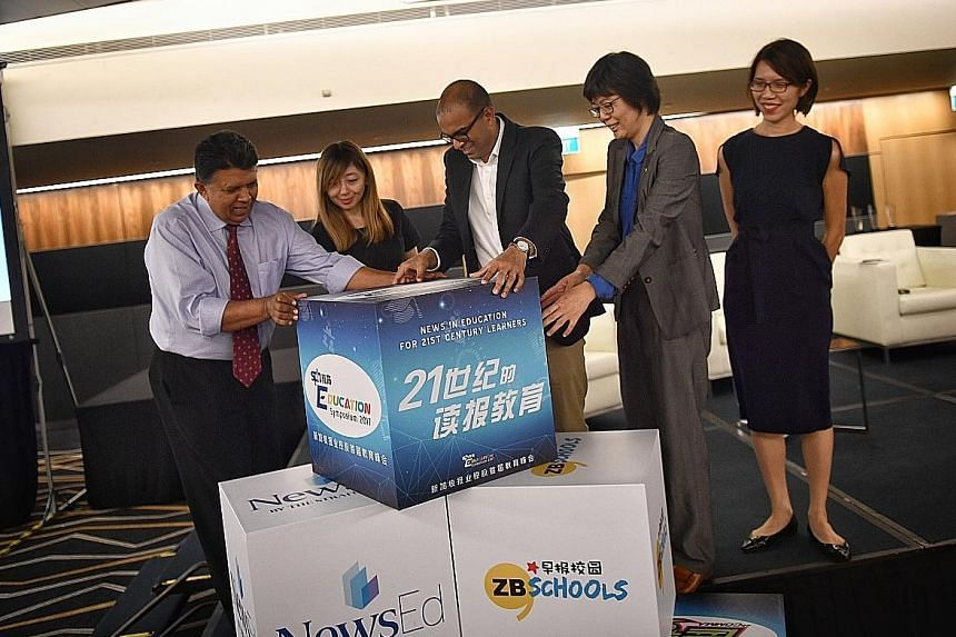 Senior Minister of State Janil Puthucheary (centre) at the launch yesterday with (from left) SPH deputy chief executive Patrick Daniel; ST executive editor Sumiko Tan; SPH Chinese Media Group head Lee Huay Leng; and Ms Loh Woon Yen, the group's vice-