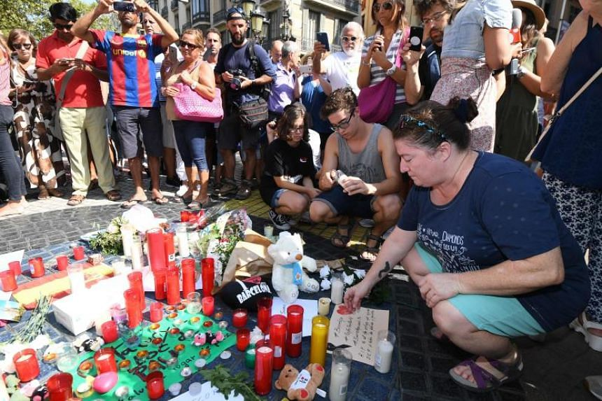 People gathering on La Ramblas boulevard on Aug 18 to pay tribute to victims of the Barcelona attack. Experts expect such attacks to become more common, as terrorists aim for more soft targets..