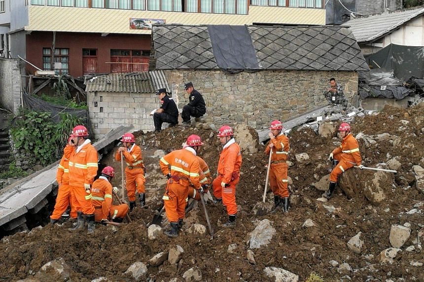 Chinese rescue workers are seen at the site of a landslide in Bijie on Aug 28, 2017.