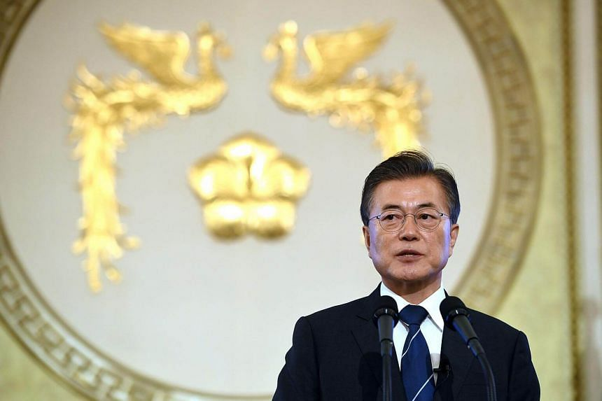 South Korea's President Moon Jae In speaks during a press conference marking his first 100 days in office at the presidential house in Seoul on Aug 17, 2017.
