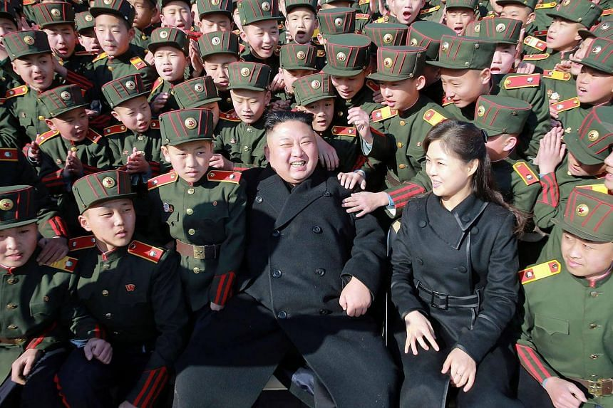 North Korean leader Kim Jong Un (centre) and his wife Ri Sol-Ju (front, second right) visiting the Mangyongdae Revolutionary School in Pyongyang.
