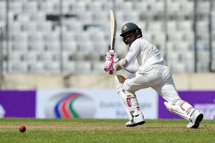 Bangladeshi cricket captain Mushfiqur Rahim plays a shot during the first day of the first test cricket match between Bangladesh and Australia at the Sher-e-Bangla National Cricket Stadium in Dhaka on Aug 27, 2017.