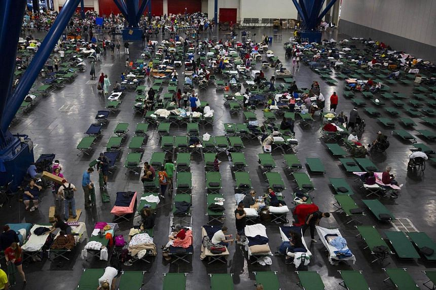 Evacuees fill up cots at the George Brown Convention Centre that has been turned into a shelter run by the American Red Cross to house victims of the high water from Hurricane Harvey.