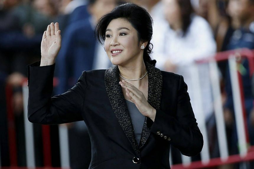 Former Thai prime minister Yingluck Shinawatra waves to supporters as she arrives to deliver closing statements in her trial at the Supreme Court's Criminal Division for Persons Holding Political Positions in Bangkok on Aug 1, 2017.