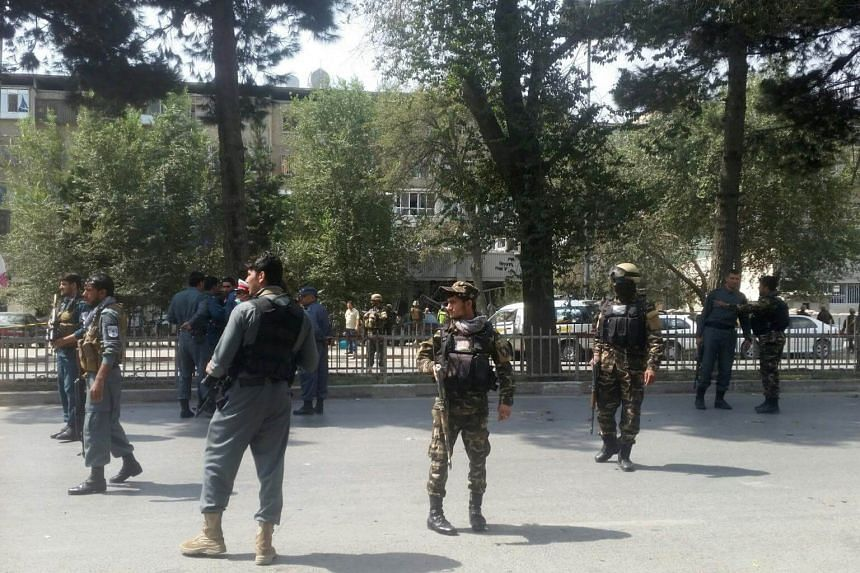 Afghan security forces keep watch at the site of attack in Kabul, Afghanistan Aug 29, 2017.