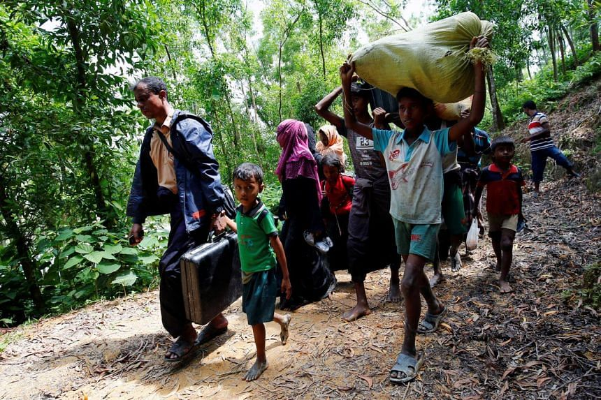 Rohingya people walk towards the makeshift shelter near the Bangladesh-Myanmar border, after being restricted by the members of Border Guards Bangladesh (BGB), to further enter the Bangladesh side, in Cox's Bazar, Bangladesh on Aug 28, 2017.