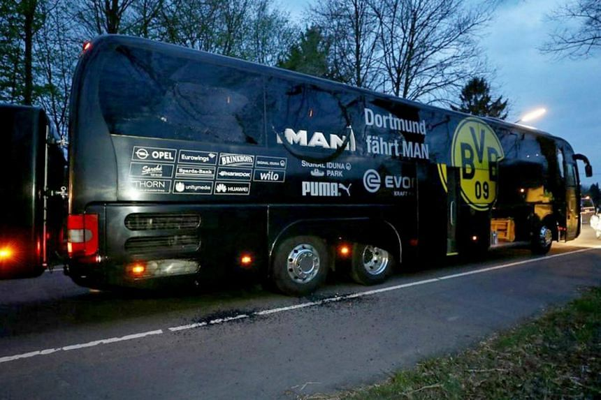 The damaged team bus of Borussia Dortmund stands on a street after it was hit by three explosions in Dortmund, Germany, on April 11, 2017.