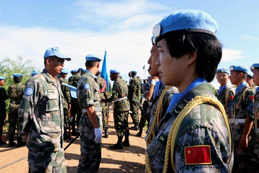 Chinese Peacekeepers in the United Nations Mission to South Sudan (UNMISS) parade during the International Day of United Nations Peacekeepers in Juba, South Sudan on May 29, 2017.