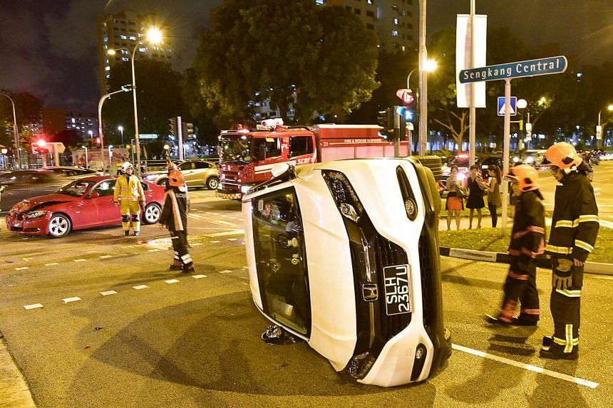 Accident involving a white Honda Vezel and A red BMW 320i at the junction of Sengkang Central and Buangkok Drive on Aug 29, 2017.