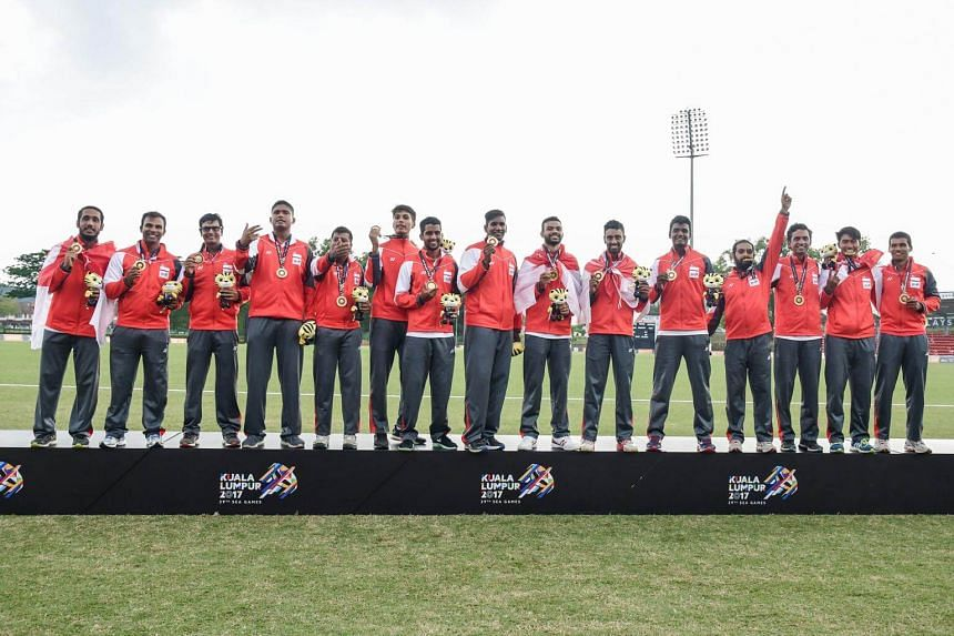 Singapore's cricket team with their gold medals at the victory ceremony.