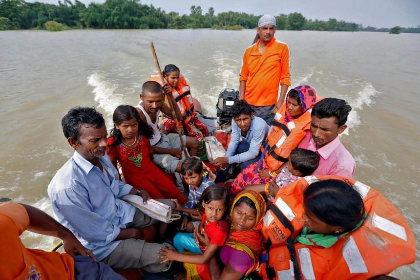 People are rescued from a flooded village in the eastern state of Bihar, India Aug 22, 2017.