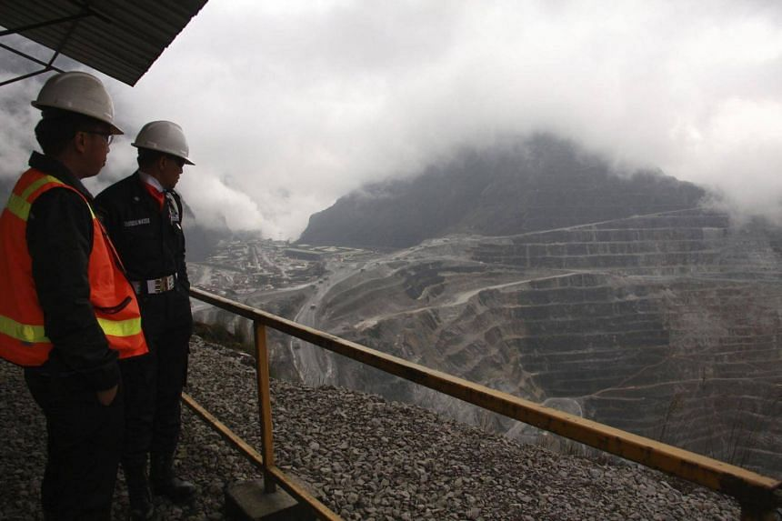 Freeport security personnel looking on at the Freeport McMoRan's Grasberg mining complex, one of the world's biggest gold and copper mines, located in Indonesia's remote eastern Papua province.