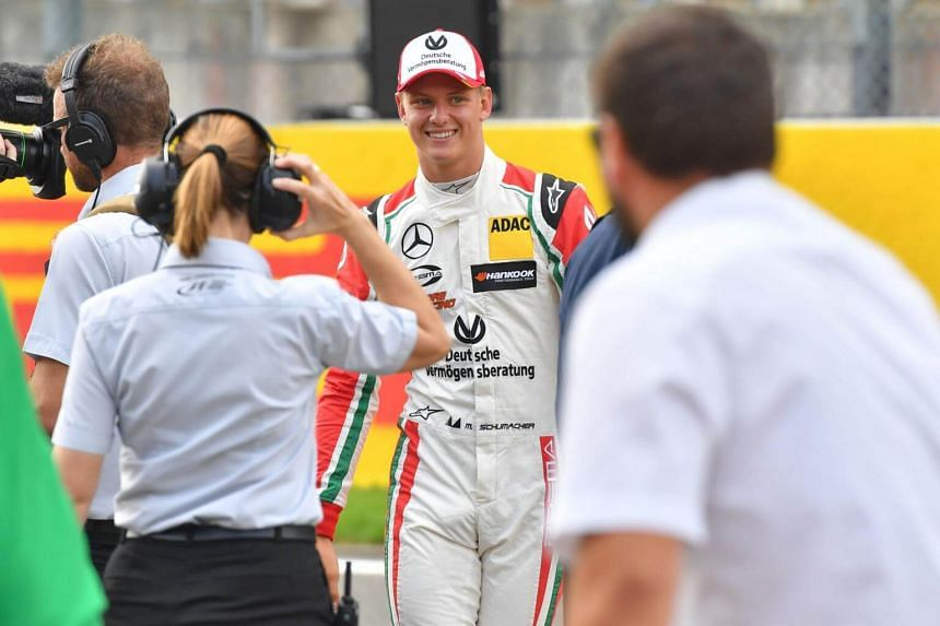 Mick Schumacher, German racing driver and son of seven-time Formula One champion Michael Schumacher, gives an interview after driving a Benetton B194 car during demonstration laps on the occasion of Michael Schumacher's 25th first Formula One victory