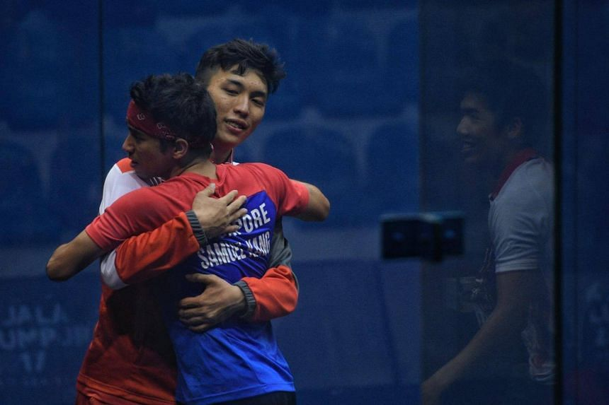 Samuel Kang of Singapore celebrates with compatriot Benedict Chan after defeating Philippines during the SEA Games men's squash team finals held on Aug 29, 2017.