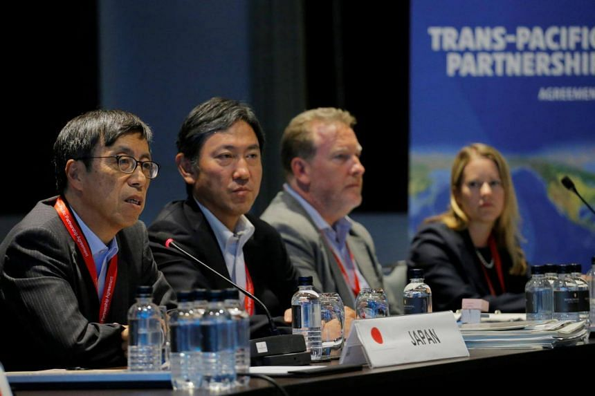Japan's chief trade negotiator Kazuyoshi Umemoto (left) speaks at the Trans Pacific Partnership seniors leaders meeting in Sydney, Australia Aug 28, 2017.