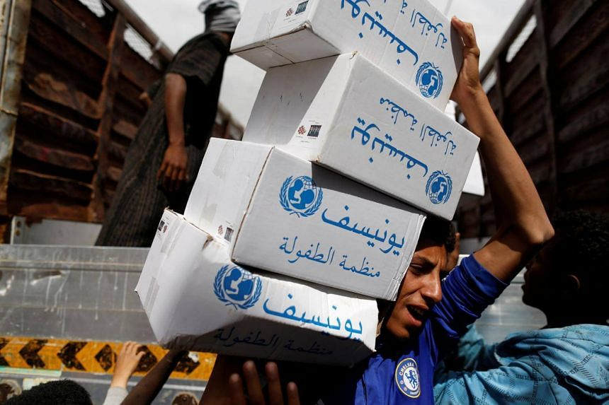 A volunteer carries hygiene kits provided by UNICEF, amid a cholera outbreak, in Sanaa, Yemen on May 24, 2017.