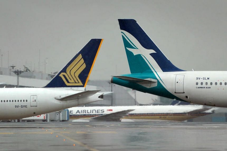 A Silkair (right) and a Singapore Airlines (left) plane parked at Changi Airport.