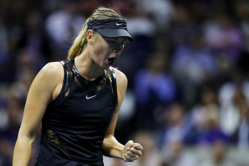 Maria Sharapova of Russia reacts during her US open first round Women's Singles match against Simona Halep.