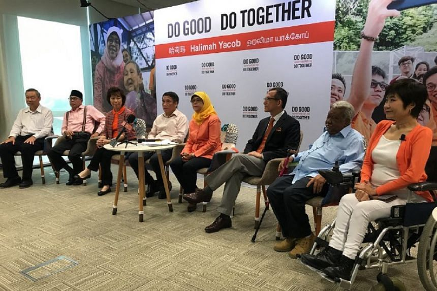(From left) Mr Lim Hock Chee, Mr Yusof Ismail, Ms Mary Liew, Mr Lawrence Leow, Madam Halimah Yacob, Mr Simon Tay, Mr G. Muthukumarasamy and Ms Chia Yong Yong.