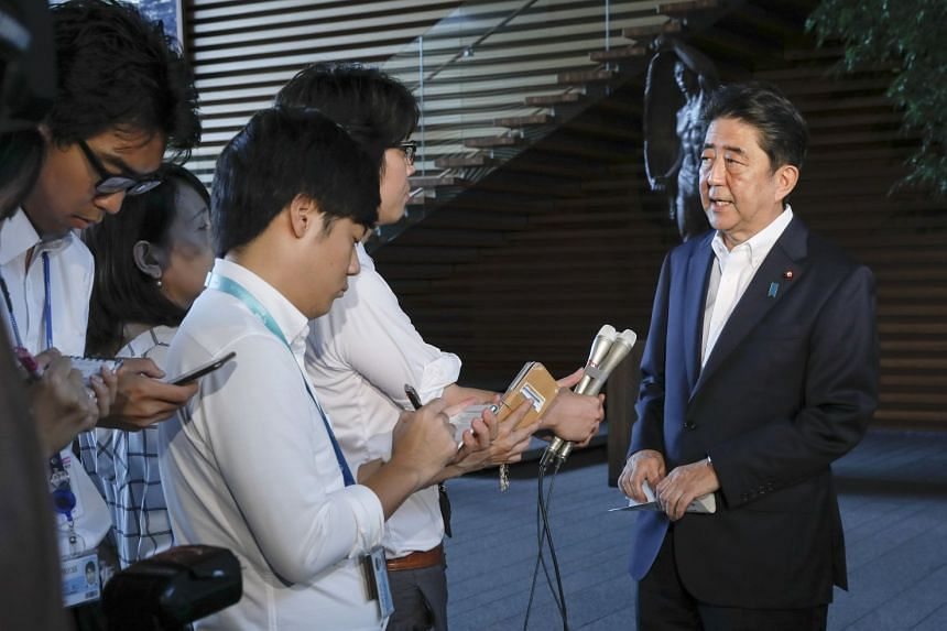 Japanese Prime Minister Shinzo Abe (right) talks to journalists after speaking with US President Donald Trump at the prime minister's official residence in Tokyo.
