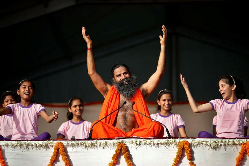 Yoga guru Baba Ramdev performs yoga at a four-day long camp in Ahmedabad, India on June 18, 2017