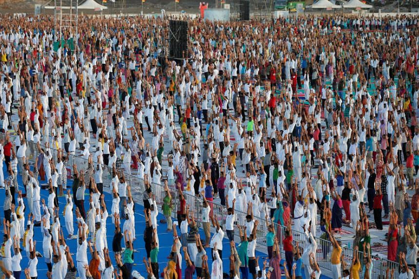 People perform yoga during a four-day long camp by yoga guru Baba Ramdev in Ahmedabad, India on June 18, 2017.