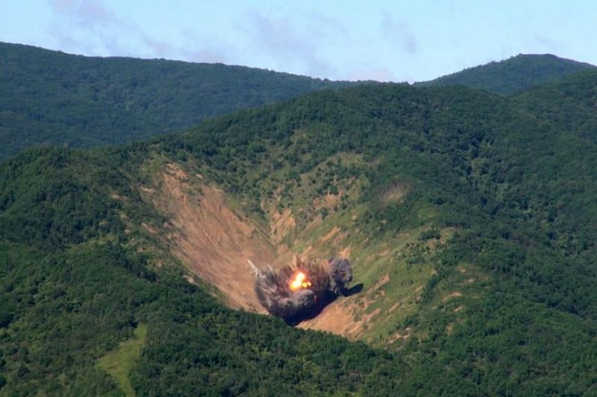 A handout photo made available by South Korean Air Force shows MK84 bombs, dropped by South Korean F-15K fighters, hitting a simulated target at the Pilseung Range in the eastern province of Gangwon, South Korea, on Aug 29, 2017, hours after North Ko