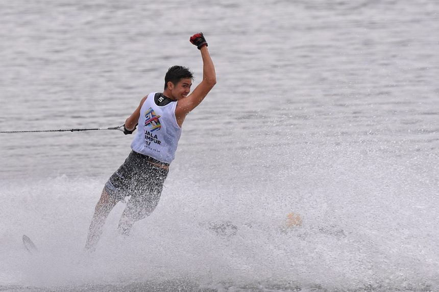 Defending champion Mark Leong celebrates after winning the men's slalom water skiing on Aug 29, 2017.