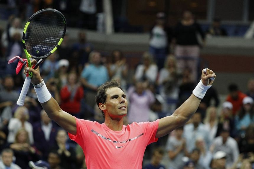 Nadal reacts after defeating Dusan Lajovic of Serbia.