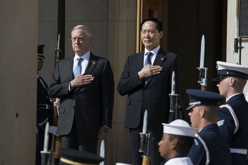 Mattis (left) welcomes South Korea's Defence Minister Song Young-moo (right) to the Pentagon for North Korea talks.