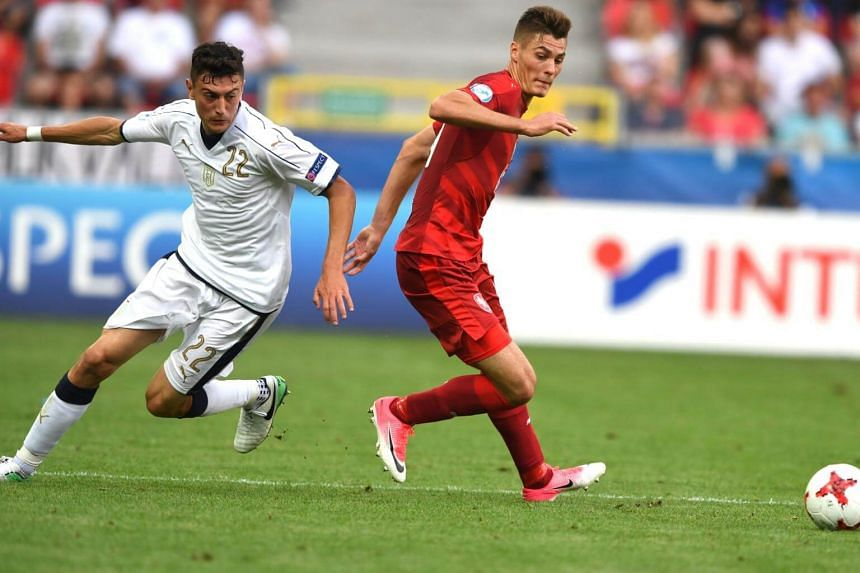 Italy's defender Alex Ferrari (left) and Czech Republic's midfielder Patrik Schick vie for the ball during the UEFA U-21 European Championship Group C football match in Tychy, Poland, on June 21, 2017.