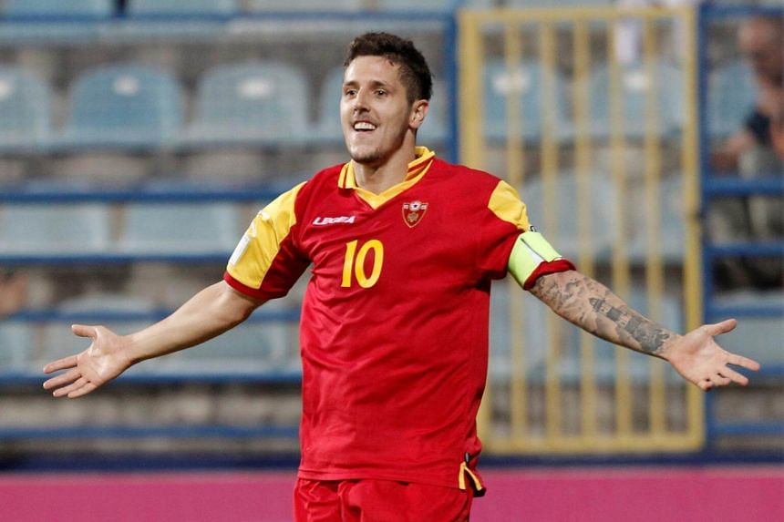 Montenegro's Stevan Jovetic celebrates scoring their fourth goal to complete his hat-trick during the 2018 World Cup Qualifying European Zone at Podgorica City Stadium in Podgorica, on June 10, 2017.
