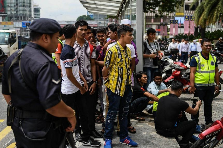 Malaysian police detain demonstrators during a protest against the persecution of Muslim ethnic minority Rohingya in Myanmar, in Kuala Lumpur on Aug 30, 2017.