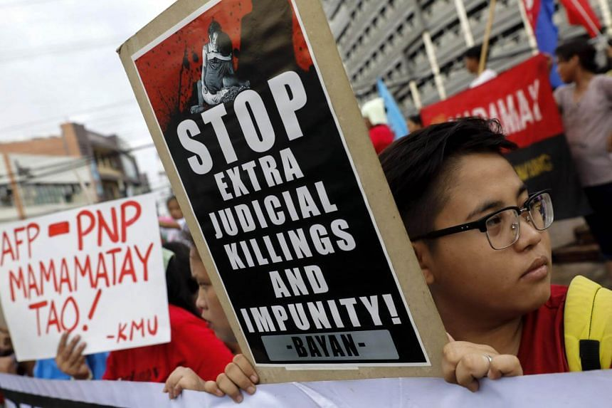Human rights advocates hold placards during a protest against extra-judicial killings (EJK) and Philippine President Rodrigo Duterte's war on illegal drugs in Quezon City, east of Manila, Philippines, on Aug 18, 2017.