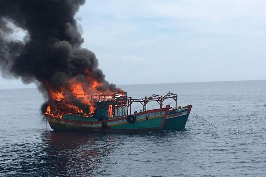 The boat was set fire at sea off the coast of the northern state of Kelantan, the first time Malaysian authorities have resorted to such action.