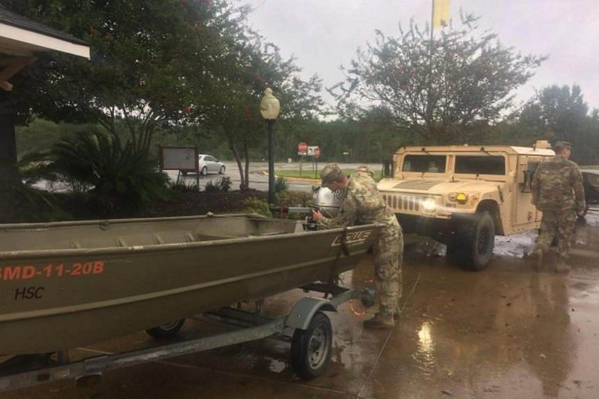 Louisiana National Guardsmen from the third Battalion, 156th Infantry Regiment, 256th Infantry Brigade Combat Team working around the clock to ensure that residents in danger of flooding from Tropical Storm Harvey are safe in Lake Charles, on Aug 29,