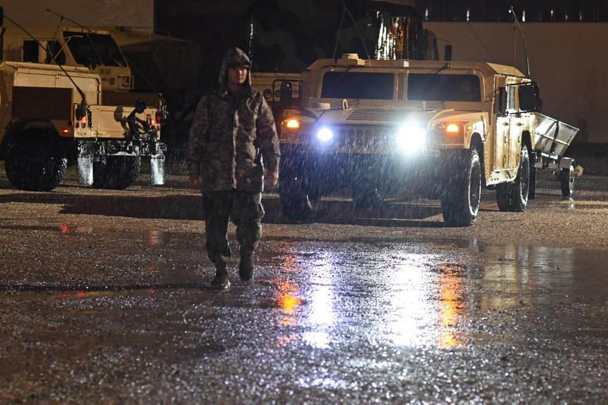 Louisiana National Guardsmen from the third Battalion, 156th Infantry Regiment, 256th Infantry Brigade Combat Team working around the clock to ensure that residents in danger of flooding from Tropical Storm Harvey are safe in Lake Charles, Louisiana,