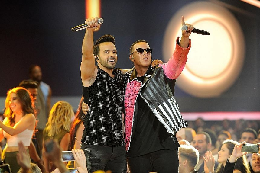 Puerto Rican pop singer Luis Fonsi (far left) and reggaeton star Daddy Yankee at the Billboard Latin Music Awards in April in Coral Gables, Florida, where they performed the hit song Despacito.