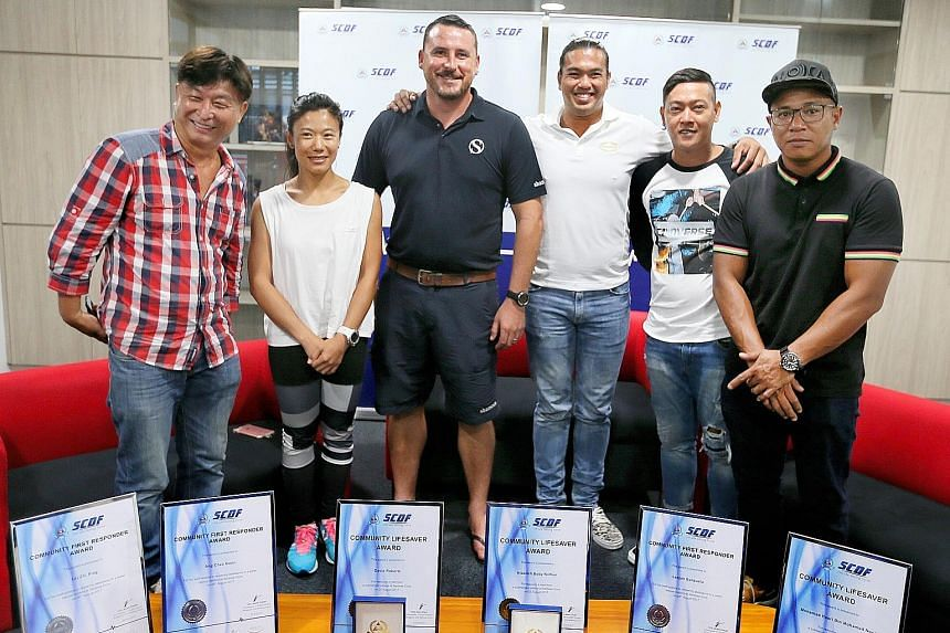 (From left) Mr Ang Chee Boon, Ms Lei Zhi Ping, Mr David Roberts, Mr Nicolich Boby Noman, Mr Leojan Banzuela and Mr Mohammad Hasir Mohammad Yoor were presented with the Community Lifesaver and Community First Responder awards at the Sentosa Fire Stati